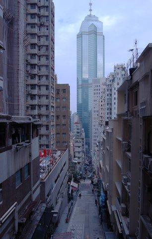 Looking down narrow streets to a skyscraper in Central