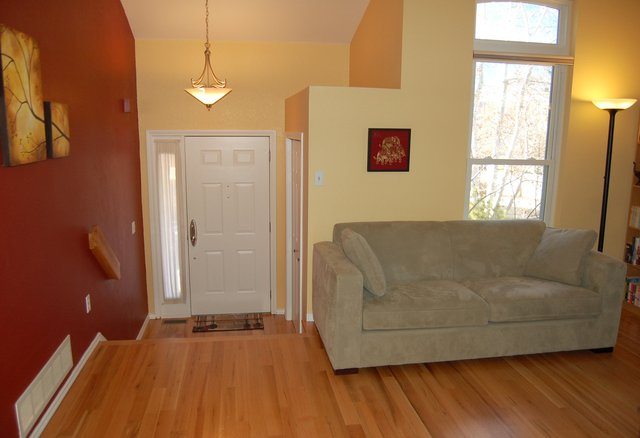 Entryway and sofa with new hard wood floors