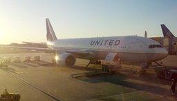 United 777-200 waiting at the gate at Narita International Airport