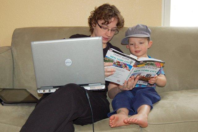 Kiesa helps Calvin look through the New York City guidebook