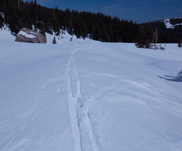 Ski tracks leading away from Lake Isabelle