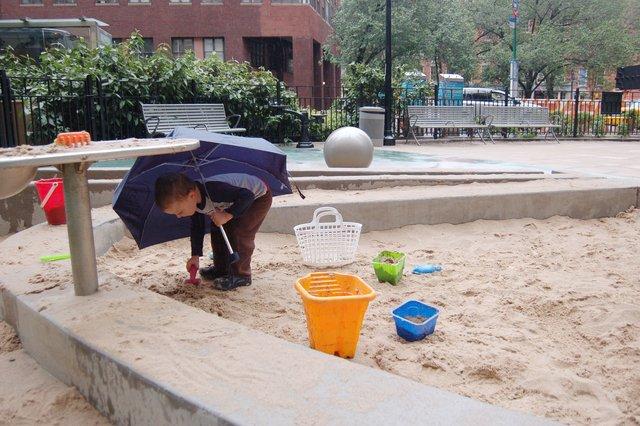 Calvin plays in the rain near Wall Street