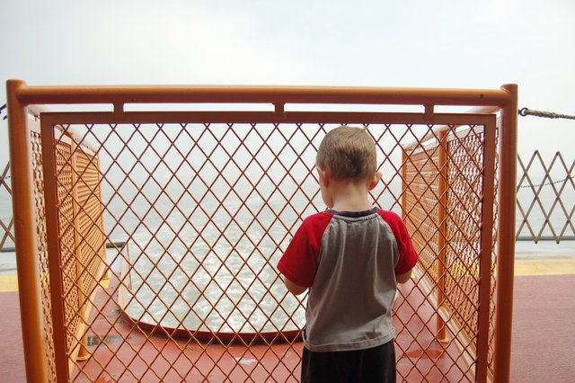 Calvin watches the harbor recede from the stern of the Staten Island Ferry