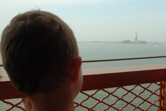 Calvin watches the Statue of Liberty