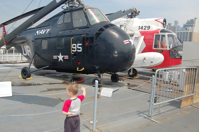 Calvin with two helicoptors on the deck of the USS Intrepid