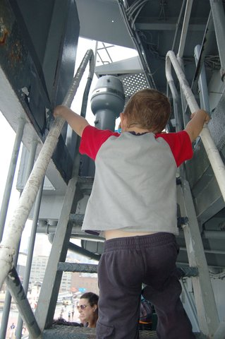 Calvin climbs to the bridge of the USS Intrepid