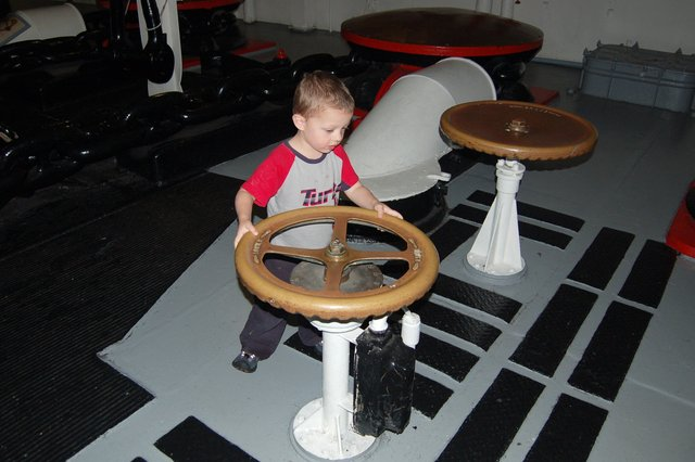 Calvin tries to turn the anchor chain on the USS Intrepid