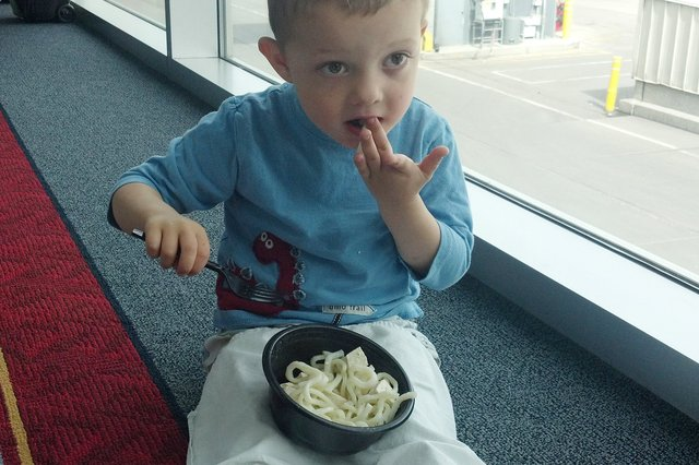 Calvin eats noodle and tofu
