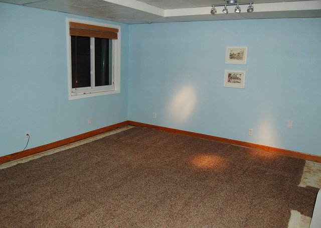 Basement with carpet unrolled to dry out
