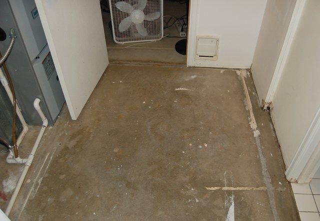 Basement-adjacent room with carpet removed