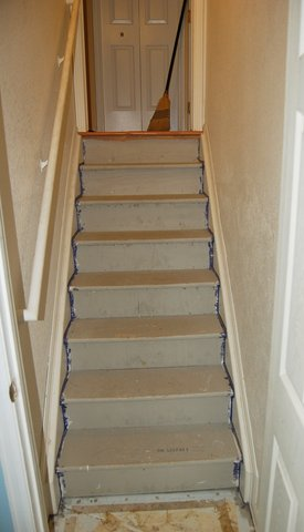 Basement stairs with carpet removed
