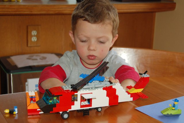 Calvin plays with the Lego Seahawk helicopter
