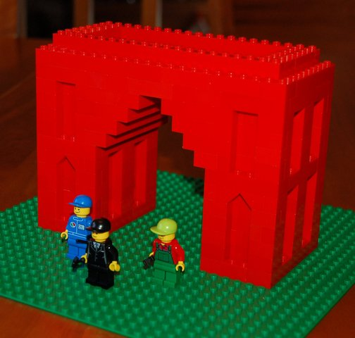 Lego arch monument, with its minifig builders