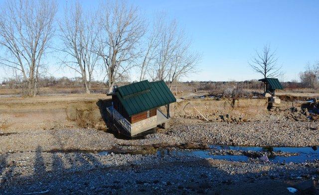 Flood-damaged pit toilet at Pella Crossing