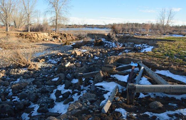 Flood-damaged parking lot at Pella Crossing