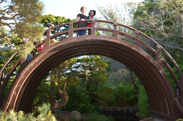 Kiesa and Calvin at the moon bridge at the Japanese Tea Garden