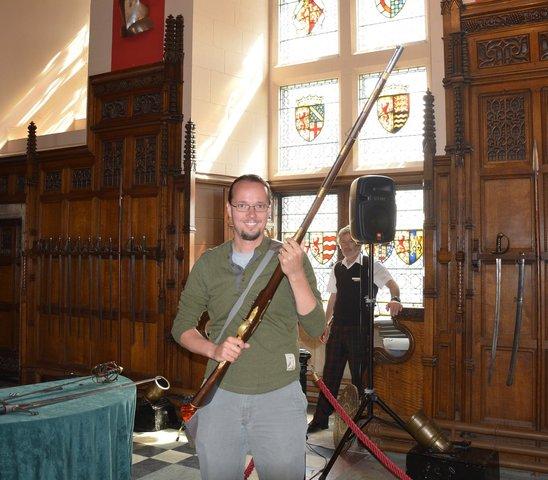 Jaeger holds a 19th-century flintlock musket at Edinburgh Castle