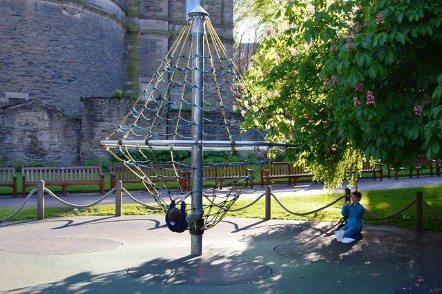 Kiesa photographs Calvin playing in Princes Street Gardens