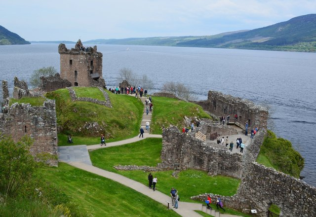 Tourists traipse over the ruins of Urquhart Castle
