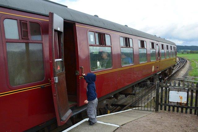 Calvin boards the Strathspey Steam Railway carriage
