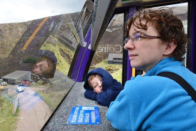 Calvin and Kiesa ride the funicular railway at CairnGorm Mountain
