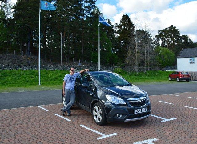 Jaeger with his rental Vauxhall Mokka