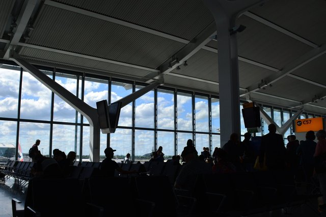 Passengers wait at gate C57 at Heathrow Terminal 5