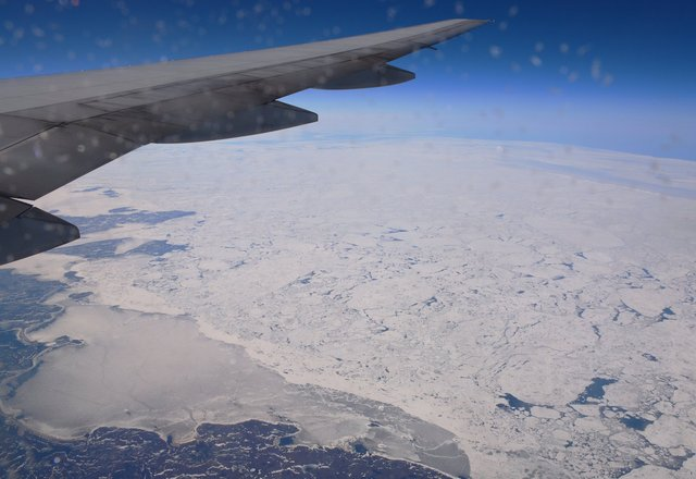 Sea ice and the coast of Newfoundland and Labrador under G-YMMB's wing