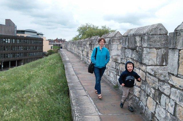 Kiesa and Calvin walk on the York city walls
