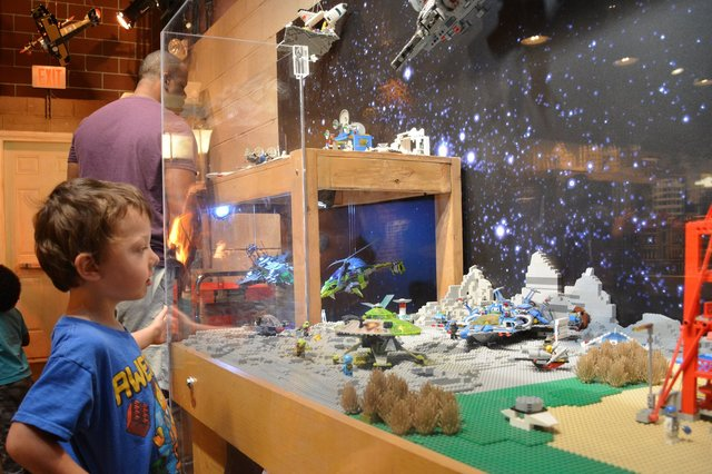 Calvin looks at the space Legos
