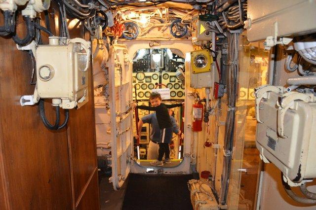 Calvin walks through a hatch on B-39