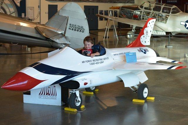 Calvin in an Air Force recruiting F-16 model