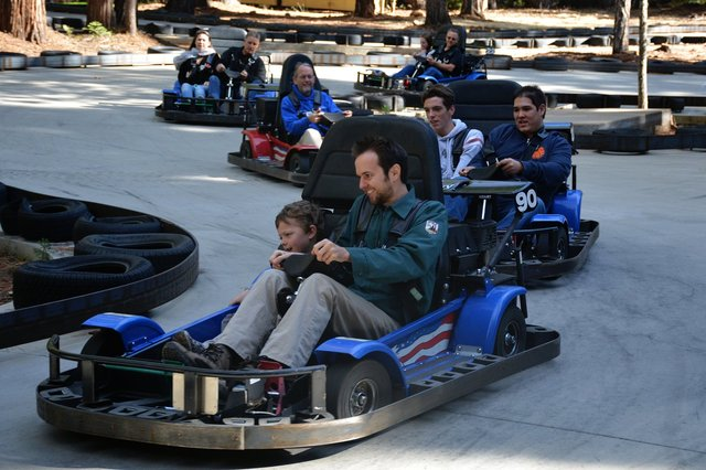 Calvin rides go-karts with Uncle Willy