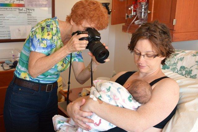 Grandma takes pictures of Julian while Kiesa holds him