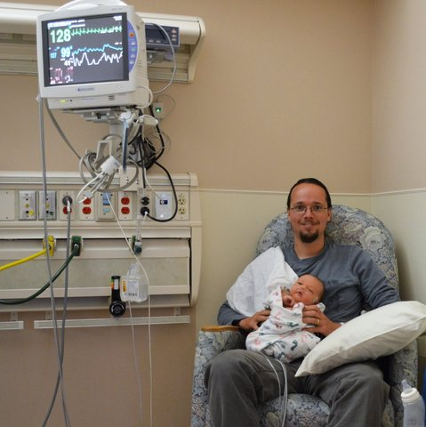 Jaeger holds Julian in the NICU
