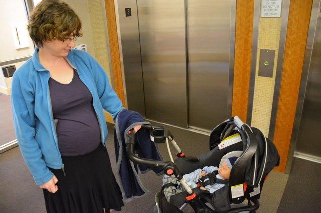 Kiesa waits for the elevator to take Julian home