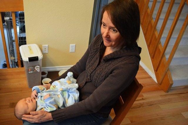 Nana holds Julian at home
