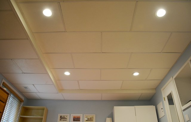 Basement ceiling with new tiles