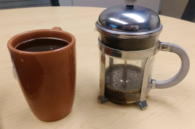 French press and fresh coffee on conference room table