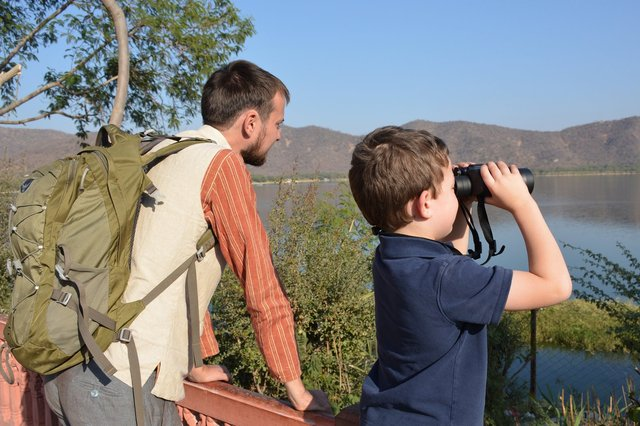 Calvin looks at Jal Mahal Sagar with Uncle Willy