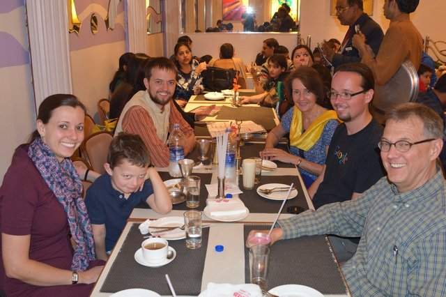 Aunt Bethany, Calvin, Uncle Willy, Nana, Jaeger, and Grandpa at Christmas dinner in Jaipur