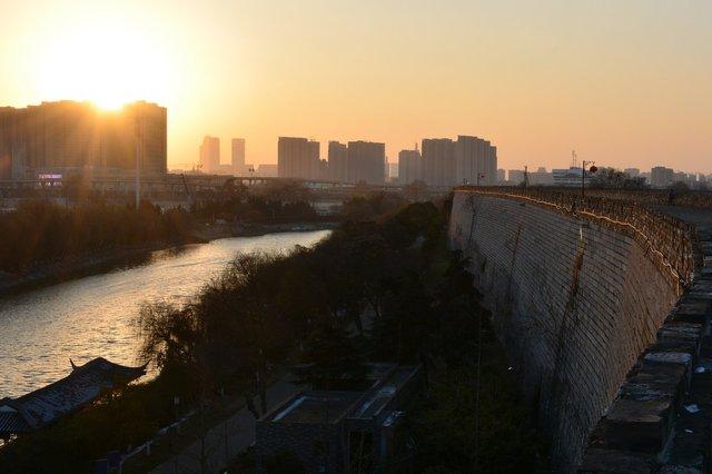 Nanjing city walls and Qinhuai River at dusk