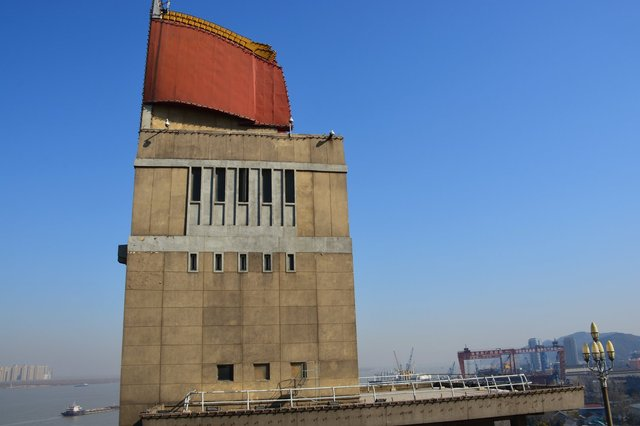Dramatic tower on the eastern approach to the Yangzee River Bridge