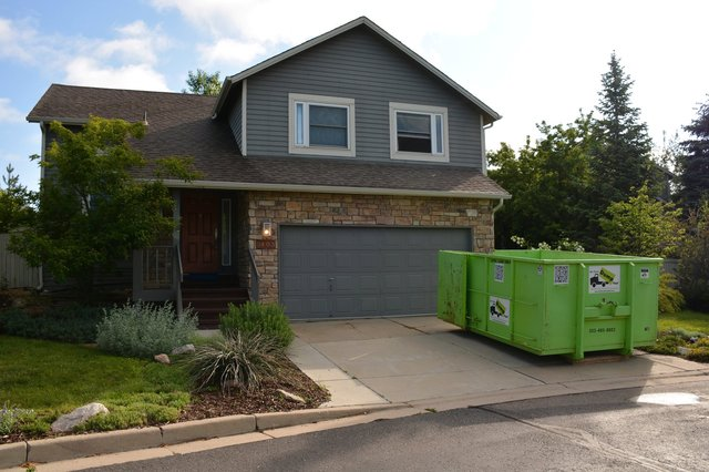 House on Glendale Gulch Circle with dumpster