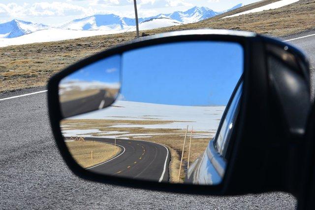 Trail Ridge Road through a rear-view mirror