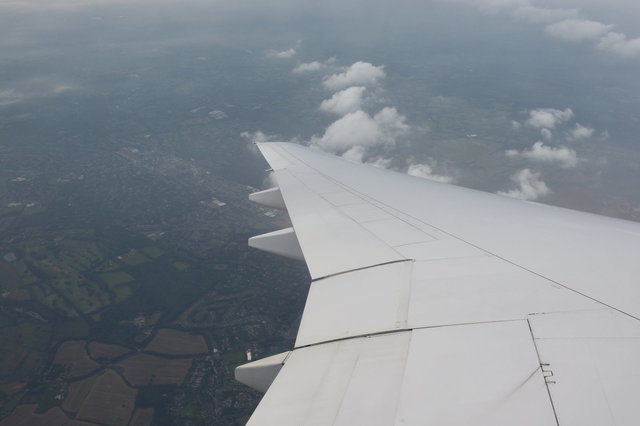 N783UA wing descending over the English countryside
