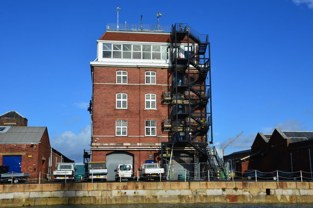 Old brick building with a modern fire escape at the Portsmouth Historic Dockyards