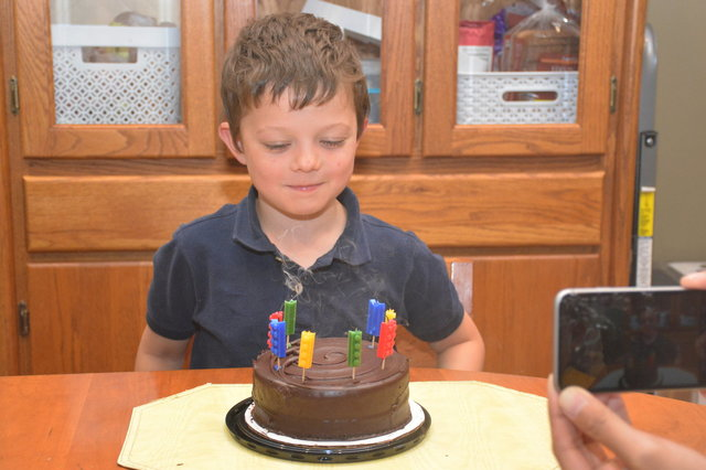 Calvin blows out his 8th birthday candles
