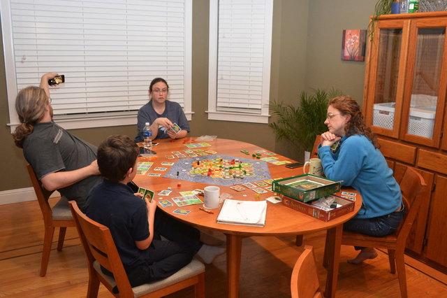Yanthor, Anya, Calvin, and Kiesa play Cities and Knights of Catan