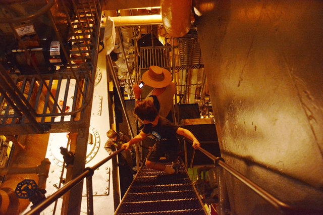 Calvin descends into the engine room on SS Jeremiah O'Brien